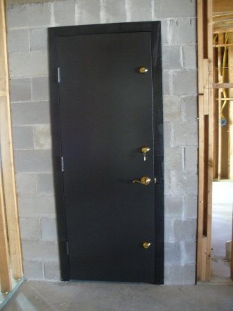 Triple deadbolts on FEMA safe room door.