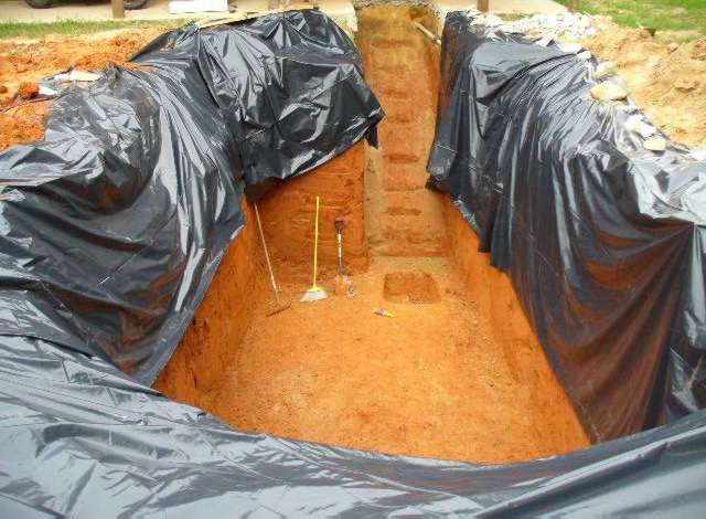 hole for steel vault / shelter. Plastic is to keep dirt wall from drying out and flaking off into hole.