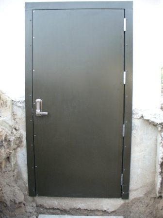 Bullet Resistant Door located into residence. Concrete Tunnel to be added  for entry into bomb shelter.